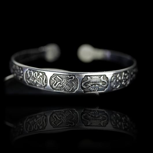 Metallarmband 8 Glück verheißende Symbole - dünn